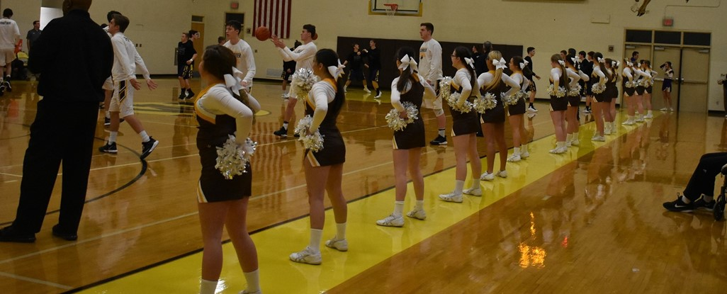 High School Cheerleaders at a Boys Basketball Game