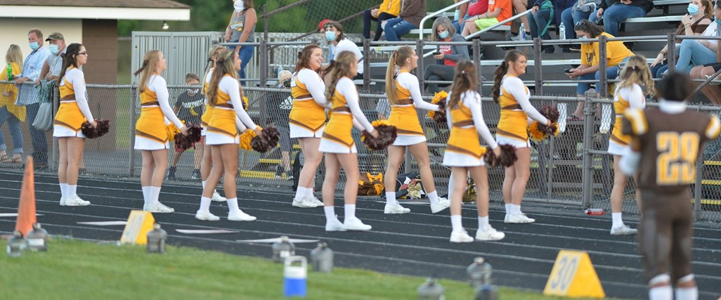High School Varsity Cheerleaders at the game