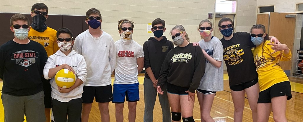 8th grade team against staff volleyball game