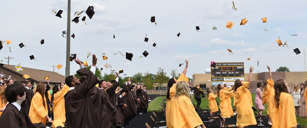 Seniors throwing their caps into the air