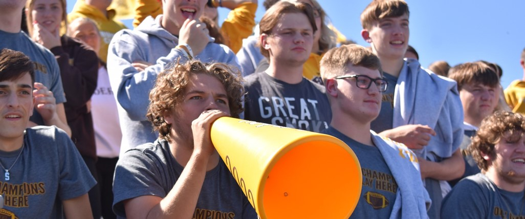 Students cheering for the football team