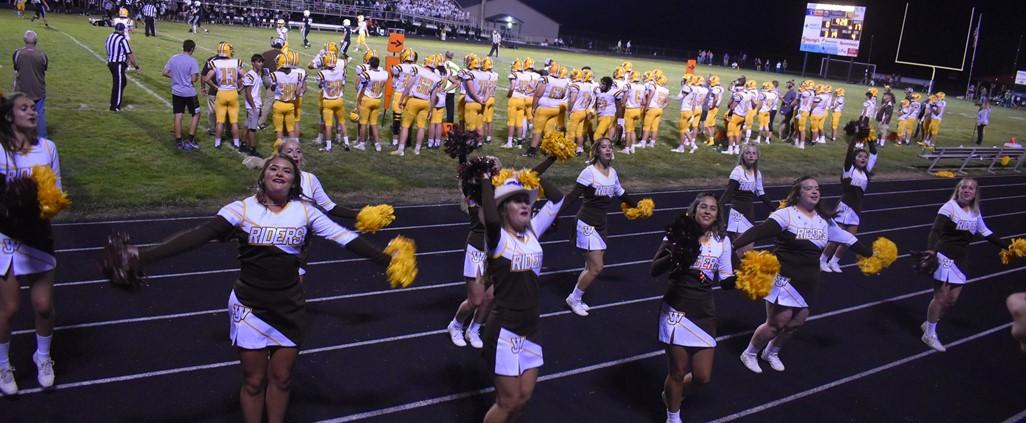 Varsity cheerleaders at the football game