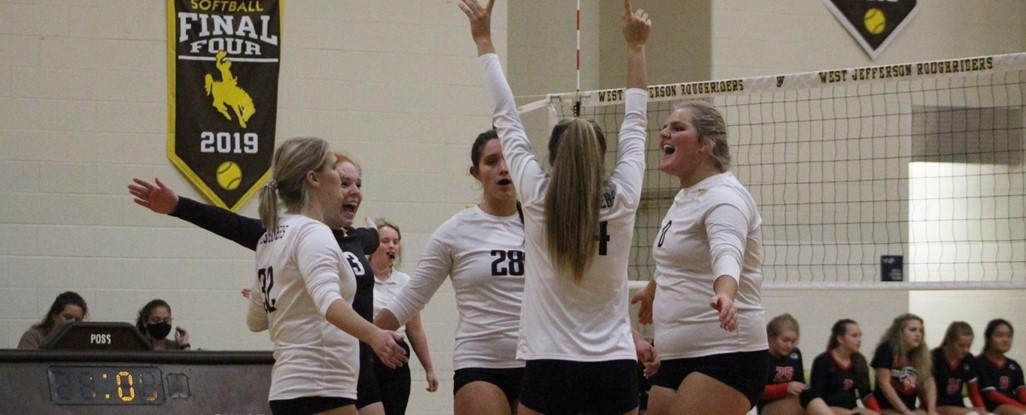 volleyball players celebrate